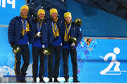 (L-R) Gold medalists Marcus Hellner, Johan Olsson, Daniel Richardsson and Lars Nelson of Sweden celebrate on the podium during the medal ceremony for the Cross Country Men's 4 x 10 km Relay on day ten of the Sochi 2014 Winter Olympics at the Medals Plaza on February 17, 2014 in Sochi, Russia.