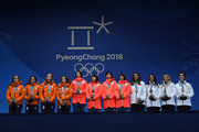 Silver medalists Marrit Leenstra, Lotte Van Beek, Ireen Wust and Antoinette De Jong of the Netherlands, gold medalists Miho Takagi, Ayaka Kikuchi, Ayano Sato and Nana Takagi of Japan and bronze medalists Heather Bergsma, Brittany Bowe, Mia Manganello and Carlijn Schoutens of the United States stand on the podium during the medal ceremony for Speed Skating - Ladies' Team Pursuit on day 13 of the PyeongChang 2018 Winter Olympic Games at Medal Plaza on February 22, 2018 in Pyeongchang-gun, South Korea.