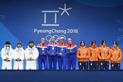 Silver medalists Seung-Hoon Lee, Jaewon Chung, Min Seok Kim of Korea, gold medalists Havard Bokko, Sindre Henriksen, Simen Spieler Nilsen and Sverre Lunde Pedersen of Norway and bronze medalists Koen Verweij, Patrick Roest, Sven Kramer and Jan Blokhuijsen of the Netherlands celebrate during the medal ceremony for Speed Skating - Men's Team Pursuit on day 13 of the PyeongChang 2018 Winter Olympic Games at Medal Plaza on February 22, 2018 in Pyeongchang-gun, South Korea.