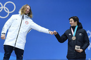 (L-R) Gold medalist David Wise of the United States and bronze medalist Nico Porteous of New Zealand congratulate each other during the medal ceremony for Freestyle Skiing - Men's Ski Halfpipe on day 13 of the PyeongChang 2018 Winter Olympic Games at Medal Plaza on February 22, 2018 in Pyeongchang-gun, South Korea.