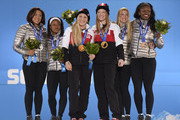 (L-R) Silver medalists Elana Meyers and Lauryn Williams of the United States team 1, gold medalists Kaillie Humphries and Heather Moyse of Canada team 1 and bronze medalists Jamie Greubel and Aja Evans of the United States team 2 celebrate on the podium during the medal ceremony for the Women's Bobsleigh on day thirteen of the Sochi 2014 Winter Olympics at  at Medals Plaza on February 20, 2014 in Sochi, Russia.