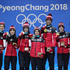 Tessa Virtue Photos - Gold medalists (L-R) Patrick Chan, Gabrielle Daleman, Kaetlyn Osmond, Meagan Duhamel, Eric Radford, Tessa Virtue and Scott Moir of Team Canada celebrate during the medal ceremony after the Figure Skating Team Event at Medal Plaza on February 12, 2018 in Pyeongchang-gun, South Korea. - Medal Ceremony - Winter Olympics Day 3
