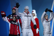 Bronze medalists Meagan Duhamel and Eric Radford of Canada and gold medalists Aljona Savchenko and Bruno Massot of Germany walk on stage during the medal ceremony for the Pair Skating Free Skating on day six of the PyeongChang 2018 Winter Olympic Games at Medal Plaza on February 15, 2018 in Pyeongchang-gun, South Korea.