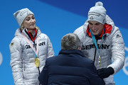 Gold medalists Aljona Savchenko and Bruno Massot of Germany shake hands with IOC President Thomas Bach during the medal ceremony for the Pair Skating Free Skating on day six of the PyeongChang 2018 Winter Olympic Games at Medal Plaza on February 15, 2018 in Pyeongchang-gun, South Korea.