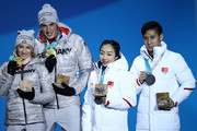 (L-R) Gold medalists Aljona Savchenko and Bruno Massot of Germany and silver medalists Wenjing Sui and Cong Han of China celebrate during the medal ceremony for the Pair Skating Free Skating on day six of the PyeongChang 2018 Winter Olympic Games at Medal Plaza on February 15, 2018 in Pyeongchang-gun, South Korea.