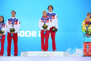 (L-R) Silver medalists Ksenia Stolbova and Fedor Klimov of Russia, gold medalists Tatiana Volosozhar and Maxim Trankov of Russia, bronze medalists Aliona Savchenko and Robin Szolkowy of Germany during the medal ceremony for the Figure Skating Pairs Free Skating on day six of the Sochi 2014 Winter Olympics at Medals Plaza on February 13, 2014 in Sochi, Russia.