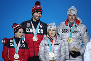 (L-R) Bronze medalists Meagan Duhamel and Eric Radford of Canada and gold medalists Aljona Savchenko and Bruno Massot of Germany celebrate during the medal ceremony for the Pair Skating Free Skating on day six of the PyeongChang 2018 Winter Olympic Games at Medal Plaza on February 15, 2018 in Pyeongchang-gun, South Korea.