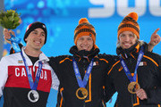 (L-R) Silver medalist Denny Morrison of Canada, gold medalist Stefan Groothuis of the Netherlands and bronze medalist Michel Mulder of the Netherlands celebrate during the medal ceremony for the Speed Skating Men's 1000m on day six of the Sochi 2014 Winter Olympics at Medals Plaza on February 13, 2014 in Sochi, Russia.