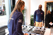 Laureus Academy Member Missy Franklin and Michael Johnson play table football during media interviews at the Mercedes Benz Building prior to the Laureus World Sports Awards on February 16, 2020 in Berlin, Germany.