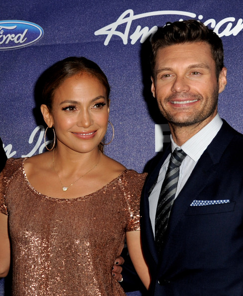 Singer Jennifer Lopez (L) and host Ryan Seacrest arrive at Fox's American Idol finalist party at The Grove on March 1, 2012 in Los Angeles, California.