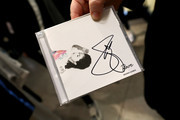 A fan holds a signed Selena Gomez CD during the Meet & Greet with Selena Gomez at PUMA Flagship on January 14, 2020 in New York City.