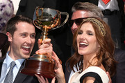 Trainer Gai Waterhouse's son Tom Waterhouse (L) and daughter Kate Waterhouse hold up the Melbourne Cup after winning with Fiorente in race 7 The Emirates Melbourne Cup during Melbourne Cup Day at Flemington Racecourse on November 5, 2013 in Melbourne, Australia.