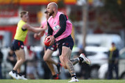 Nathan Jones of the Demons runs with the ball during a Melbourne Demons AFL training session at Gosch's Paddock on September 19, 2018 in Melbourne, Australia.