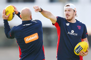 Michael Hibberd of the Demons tries to punch the ball held by Nathan Jones of the Demons during a Melbourne Demons AFL training session at Gosch's Paddock on September 3, 2018 in Melbourne, Australia.