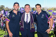 Cameron Smith and Billy Slater of the Storm pose for a photo with Minister for Sport John Eren during the Melbourne Storm Fan Day at Gosch's Paddock on October 1, 2018 in Melbourne, Australia.
