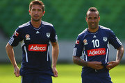 Harry Kewell of the Victory looks on with teammate Archie Thompson during a Melbourne Victory A-League training session at Olympic Park on September 14, 2011 in Melbourne, Australia.