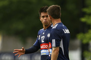 Rodrigo Vargas speaks with Harry Kewell during a Melbourne Victory A-League training session at Gosch's Paddock on October 25, 2011 in Melbourne, Australia.