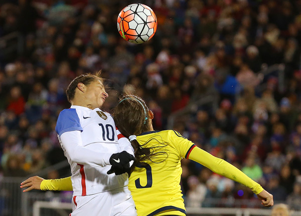 Colombia v United States [player,sports,sports equipment,team sport,ball game,football player,tournament,football,yellow,championship,net,ball,united states,colombia,east hartford,ct,half,pratt whitney stadium,carli lloyd,melissa ortiz 5]