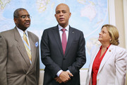 Haiti President Michel Martelly (C) makes a brief statement before a meeting with members of the House Foreign Affiars Committee, including Rep. Gregory Meeks (D-NY) (L) and Rep. Ileana Ros-Lehitnen (R-FL), in the Rayburn House Office Building on Capitol Hill February 5, 2014 in Washington, DC. Martelly likely will be pressured to hold long-delayed national and municipal elections during his meetings with members of Congress, Secretary of State John Kerry and President Barack Obama this week.