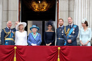 (L-R)  Prince Charles, Prince of Wales, Prince Andrew, Duke of York, Camilla, Duchess of Cornwall, Queen Elizabeth II, Meghan, Duchess of Sussex, Prince Harry, Duke of Sussex, Prince William, Duke of Cambridge and Catherine, Duchess of Cambridge watch the RAF flypast on the balcony of Buckingham Palace, as members of the Royal Family attend events to mark the centenary of the RAF on July 10, 2018 in London, England.