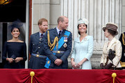 (L-R) Meghan, Duchess of Sussex, Prince Harry, Duke of Sussex, Prince William, Duke of Cambridge, Catherine, Duchess of Cambridge and Anne, Princess Royal,  watch the RAF flypast on the balcony of Buckingham Palace, as members of the Royal Family attend events to mark the centenary of the RAF on July 10, 2018 in London, England.