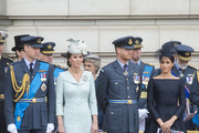 (L-R)  Prince William, Duke of Cambridge, Catherine, Duchess of Cambridge, Prince Harry, Duke of Sussex and Meghan, Duchess of Sussex during the RAF 100 ceremony at Buckingham Palace, as members of the Royal Family attend events to mark the centenary of the RAF on July 10, 2018 in London, England.