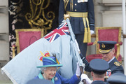 Queen Elizabeth presents The RAF with new Queen's Colours of their centenary during the RAF 100 ceremony at Buckingham Palace, as members of the Royal Family attend events to mark the centenary of the RAF on July 10, 2018 in London, England.