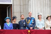 Queen Elizabeth II, Meghan, Duchess of Sussex, Prince Harry, Duke of Sussex, Prince William Duke of Cambridge, Catherine, Duchess of Cambridge and Princess Anne, Princess Royal watch the RAF 100th anniversary flypast from the balcony of Buckingham Palace on July 10, 2018 in London, England.
