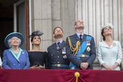 (L-R)  Queen Elizabeth II, Meghan, Duchess of Sussex, Prince Harry, Duke of Sussex, Prince William, Duke of Cambridge and Catherine, Duchess of Cambridge watch the RAF flypast on the balcony of Buckingham Palace, as members of the Royal Family attend events to mark the centenary of the RAF on July 10, 2018 in London, England.