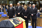 (L-R)  Regional chairman of the Saxony CDU Stanislaw Tillich, President of the Constitutional Court Andreas Vosskuhle, Chancellor Angela Merkel and President of the Bundestag Norbert Lammert attend the state memorial ceremony to honor Hans-Dietrich Genscher at World Congress Center on April 17, 2016 in Bonn, Germany. Genscher, a member of the German Free Democrats (FDP), served as German foreign minister from 1974 to 1992 and was widely respected as a shrewd and successful diplomat through the end of the Cold War era.