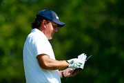 Phil Mickelson waits to play a shot on the first hole during the final round of the Memorial Tournament presented by Nationwide Insurance at Muirfield Village Golf Club on June 1, 2014 in Dublin, Ohio.