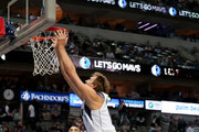 Dirk Nowitzki #41 of the Dallas Mavericks scores against Andrew Harrison #5 of the Memphis Grizzlies and Marc Gasol #33 of the Memphis Grizzlies in the first half at American Airlines Center on October 25, 2017 in Dallas, Texas.