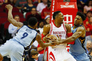 Tony Allen #9 and Alex Stepheson #35 of the Memphis Grizzlies defend against Dwight Howard #12 of the Houston Rockets during their game at the Toyota Center on March 14, 2016 in Houston, Texas.