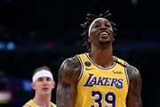 Dwight Howard #39 of the Los Angeles Lakers reacts to the officials in front of Alex Caruso #4 during the first quarter at Staples Center on February 21, 2020 in Los Angeles, California.  NOTE TO USER: User expressly acknowledges and agrees that, by downloading and or using this photograph, User is consenting to the terms and conditions of the Getty Images License Agreement.