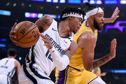 Ja Morant #12 of the Memphis Grizzlies tries to keep his dribble as he is chased by JaVale McGee #7 of the Los Angeles Lakers during the first quarter at Staples Center on February 21, 2020 in Los Angeles, California.  NOTE TO USER: User expressly acknowledges and agrees that, by downloading and or using this photograph, User is consenting to the terms and conditions of the Getty Images License Agreement.