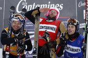 (FRANCE OUT) Xavier Kuhn (C) of France takes 1st place, Stanley Hayer of Canada takes 2nd place, and Tomas Kraus of the Czech Republic takes 3rd place during the FIS Freestyle World Cup Men's Ski Cross on January 10, 2010 in Les Contamines, France.