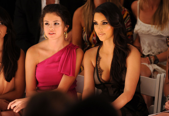 Actress Selena Gomez and Kim Kardashian attend the Beach Bunny Swimwear 2011 fashion show during Mercedes-Benz Fashion Week Swim at the Raleigh on July 16, 2010 in Miami Beach, Florida.
