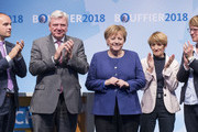 German Chancellor and leader of the German Christian Democrats (CDU) Angela Merkel, lead local CDU candidate Volker Bouffier (C) his wife Ursula Bouffier (2-R) and Lutz Koehler (L) attend a CDU Hesse state election rally on October 23, 2018 in Dieburg, Germany. Hesse is scheduled to hold state elections on October 28 and so far polls indicate the German Christian Democrats (CDU), the party of Chancellor Angela Merkel, and the German Social Democrats (SPD) will fair poorly, while both the German Greens Party and the right-wing Alternative for Germany (AfD) can expect strong gains.