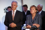 Stanislaw Tillich, prime minister of the German state of Saxony (CDU) (L) and German Chancellor Angela Merkel (CDU) attend the opening of new building of the A. Lange und Soehne watch factory in Glashuette, Germany, on August 26, 2015. The producer of high-end watches was founded in 1845 by Ferdinand Adolph Lange.