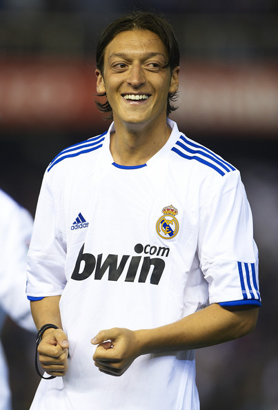 Mesut Ozil Mesut Ozil of Real Madrid celebrates after the Copa del Rey final match between Real Madrid and Barcelona at Estadio Mestalla on April 20, 2011 in Valencia, Spain.