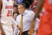 Head coach Billy Donovan of the Florida Gators looks on during a break in action against the Fresno State Bulldogs during the MetroPCS Orange Bowl Basketball Classic on December 21, 2013 at the BB&T Center in Sunrise, Florida. Florida defeated Fresno State 66-49.