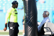 Cam Newton #1 of the Carolina Panthers talks to team owner, Jerry Richardson, in warms up ahead of their game against the Miami Dolphins at Bank of America Stadium on August 22, 2015 in Charlotte, North Carolina.