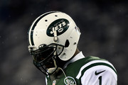 Michael Vick #1 of the New York Jets looks on during warm-ups prior to their game against the Miami Dolphins at MetLife Stadium on December 1, 2014 in East Rutherford, New Jersey.