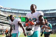 Running back Frank Gore #21 and running back Kenyan Drake #32 of the Miami Dolphins walk off field after their 20-12 win over the New York Jets at MetLife Stadium on September 16, 2018 in East Rutherford, New Jersey.