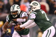 Geno Smith #7 of the New York Jets hands the ball off to Chris Ivory #33 in the first half against the Miami Dolphins during their game at MetLife Stadium on December 1, 2014 in East Rutherford, New Jersey.