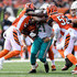 Preston Brown Photos - Shawn Williams #36 of the Cincinnati Bengals, Nick Vigil #59 and Preston Brown #52 combine to tackle Frank Gore #21 of the Miami Dolphins during the third quarter at Paul Brown Stadium on October 7, 2018 in Cincinnati, Ohio. - Miami Dolphins vs. Cincinnati Bengals
