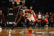 Chris Bosh #1 of the Miami Heat loses the ball as Kevin Garnett #2 of the Brooklyn Nets defends during their game at the Barclays Center on November 1, 2013 in the Brooklyn borough of New York City. NOTE TO USER: User expressly acknowledges and agrees that, by downloading and or using this photograph, User is consenting to the terms and conditions of the Getty Images License Agreement.