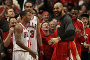 (L-R) Derrick Rose #1, Joakim Noah #13 and Carlos Boozer #5 of the Chicago Bulls celebrate late in the fourth quarter against the Miami Heat in Game One of the Eastern Conference Finals during the 2011 NBA Playoffs on May 15, 2011 at the United Center in Chicago, Illinois. The Bulls won 103-82. NOTE TO USER: User expressly acknowledges and agrees that, by downloading and or using this photograph, User is consenting to the terms and conditions of the Getty Images License Agreement