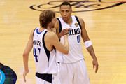 (L-R) Dirk Nowitzki #41 and Shawn Marion #0 of the Dallas Mavericks celebrate their 112-103 win against the Miami Heat in Game Five of the 2011 NBA Finals at American Airlines Center on June 9, 2011 in Dallas, Texas.  NOTE TO USER: User expressly acknowledges and agrees that, by downloading and/or using this Photograph, user is consenting to the terms and conditions of the Getty Images License Agreement.