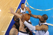 LeBron James #6 of the Miami Heat draws contact from (clockwise from R) Tyson Chandler #6, Brian Carinal #35 and Shawn Marion #0 of the Dallas Mavericks in the second half of Game Five of the 2011 NBA Finals at American Airlines Center on June 9, 2011 in Dallas, Texas.  NOTE TO USER: User expressly acknowledges and agrees that, by downloading and/or using this Photograph, user is consenting to the terms and conditions of the Getty Images License Agreement.